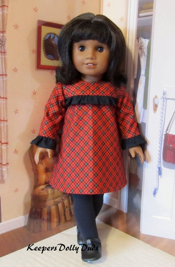 1960s Holiday dress made to fit 18 American Girl Doll. A KeepersDollyDuds Original Outfit.   $49.49  Miss Melody is modeling a smartly styled 1960s holiday dress made from a festive red, black and gold diagonal plaid printed cotton. The dress features a ruffled front bodice yoke and long sleeves. This sixties inspired dress will look fabulous on your doll this holiday season. The back fastens up with buttons.  Please note that my doll, her shoes, tights and props are not included in this…