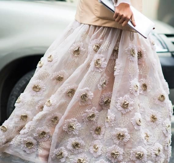 blooms on your skirt, in your hair, blooms everywhere