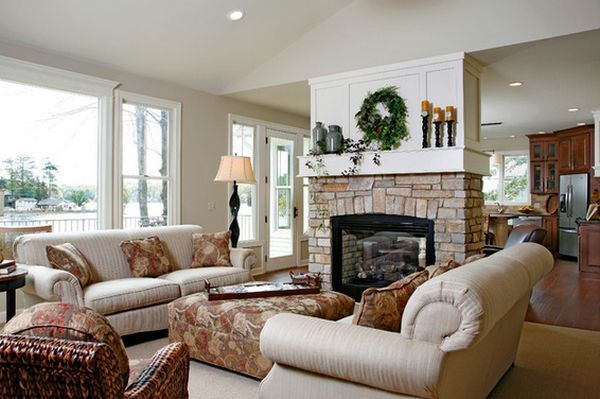 In a traditional home, the fireplace used as a room divider can be covered in stone for a lovely finishing detail in the room.
