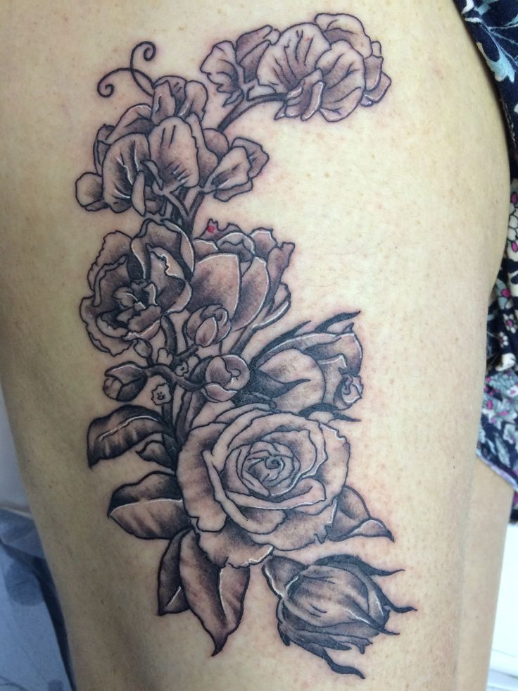 05ecf1cad Thigh rose tattoo done by Travis Allen at twisted tattoo Yaxley Www.  twistedtattoo.co
