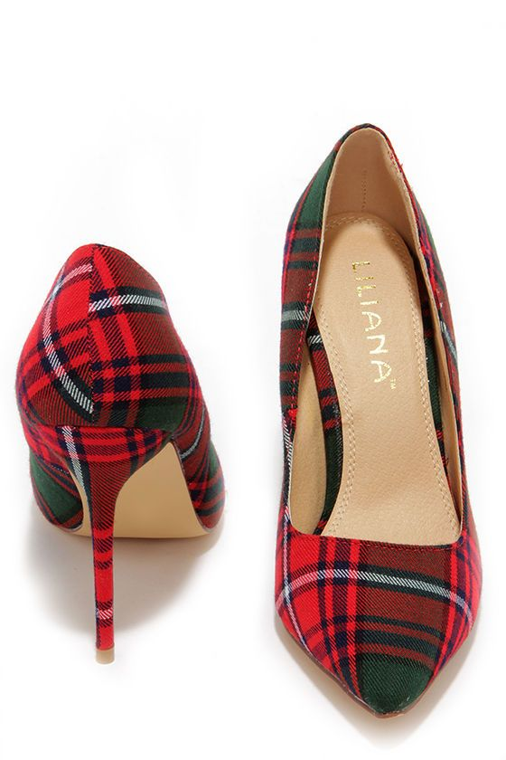 """From Highlands to high rises, the Who's Plaid! Red Plaid Pumps are sweeping the globe with their good looks! These cuties feature a red, green, white, and navy plaid fabric upper with a pointed toe. Wrapped stiletto heel measures 4"""" tall. Cushioned insole. Felted rubber sole has nonskid markings. Available in whole and half sizes. Measurements are for a size 6. All vegan friendly, man made materials."""