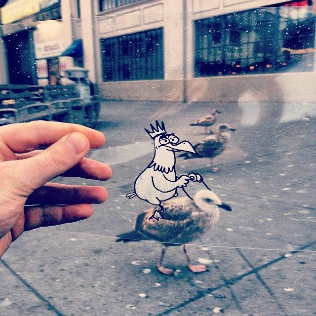 Artist Marty Cooper Inserts Cartoons Into Real-World Situations By Doodling Them On Transparency Sheets