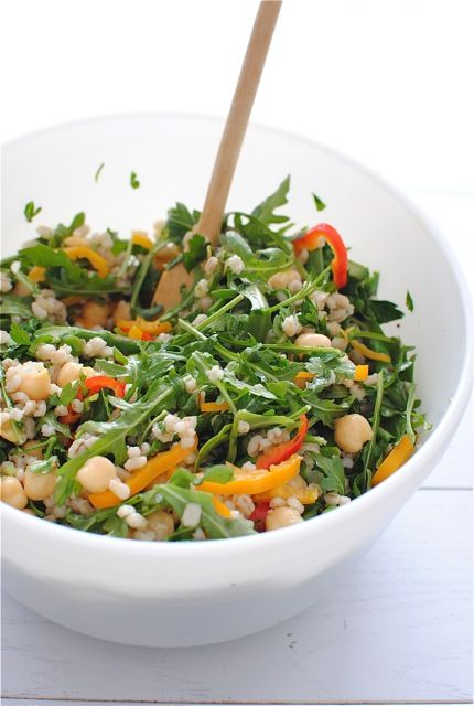 Vegetarian Barley Toss. Made with barley, olive oil, garlic, asparagus, arugula, red and orange peppers, chickpeas, sun-dried tomatoes, lemon juice, red pepper flakes, salt, pepper, and parsley.