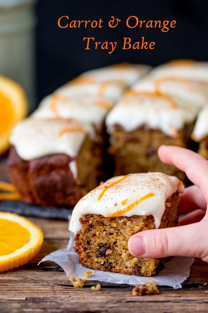 A fluffy moist carrot and orange tray bake with orange infused raisins and zesty cream cheese frosting!