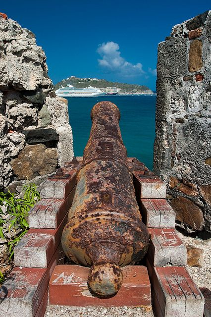 Fort Amsterdam in Philipsburg St. Maarten.    A rusty cannon lying in Fort Amsterdam aimed at a cruise ship visiting the port of St. Maarten
