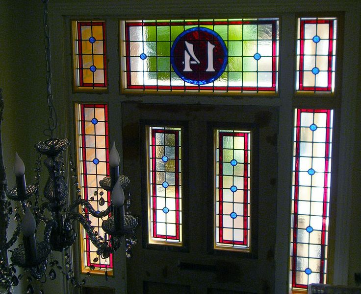 front door and side panels in new stained glass including house number detail