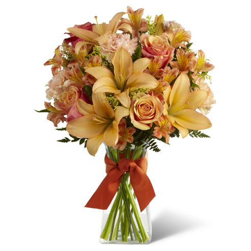 Cherry Brandy Roses, peach Asiatic Lilies, peach carnations, light orange Peruvian Lilies, solidago and lush greens are arranged to perfection is a classic clear glass vase accented with a deep orange ribbon to create an inspiring bouquet of autumn's eternal grace. http://www.sendflowers.com/product/the_ftd_country_kindness_bouquet.htm?refcode=15save #Fall #flowers
