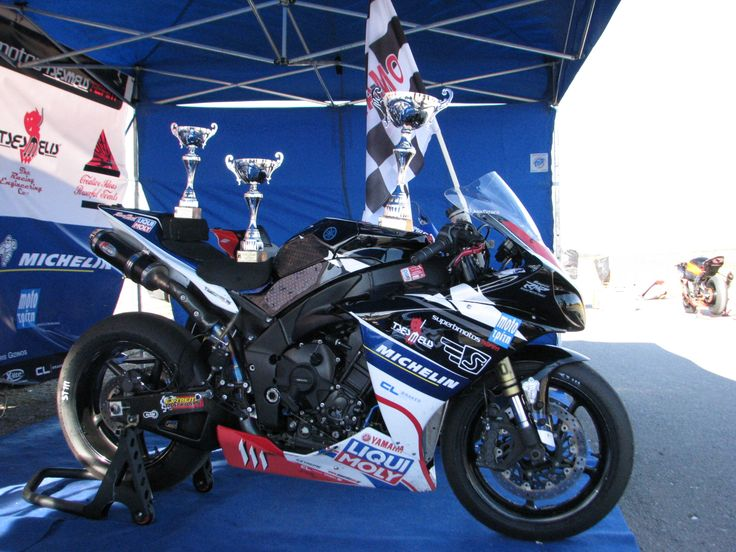 Superbmotos Racing Team bike along with trophies & checkered flag...
