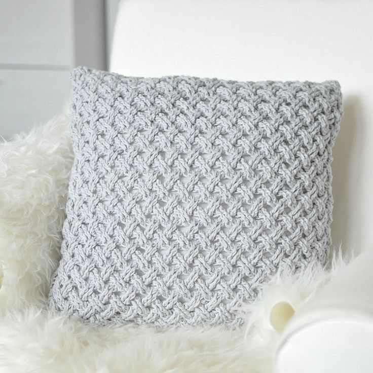 Crochet pillow made with light grey yarn @Craftsy
