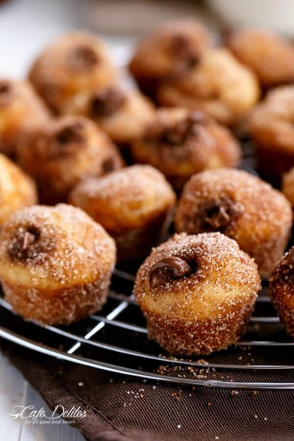 Nutella Churro Donut holes are oven baked not fried, filled with Nutella and coated in Buttery Cinnamon Sugar! A Churro fix right at home!