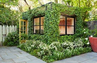 "This lovely ivy-encased art studio in San Francisco is the work of Scott Lewis Landscape Architecture who replaced a storage shed with this remarkably green shedworking atmosphere or as they put it, a ""green cube"" with ivy growing on a metal framework surrounding the studio."