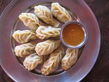 This picture shows a place of momo, a traditional food in India. Momo is a steamed bun that is filled with filling, occasionally it is just an empty piece of bread that is dipped into a spiced sauce.