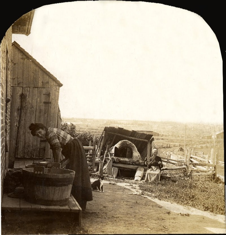 """Washing and Baking Day at a Canadian Farmhouse,  Roberval, Quebec, 1903 - Check out the old woman sitting beside the the outdoor """"pizza"""" oven, and of course the cat :)"""