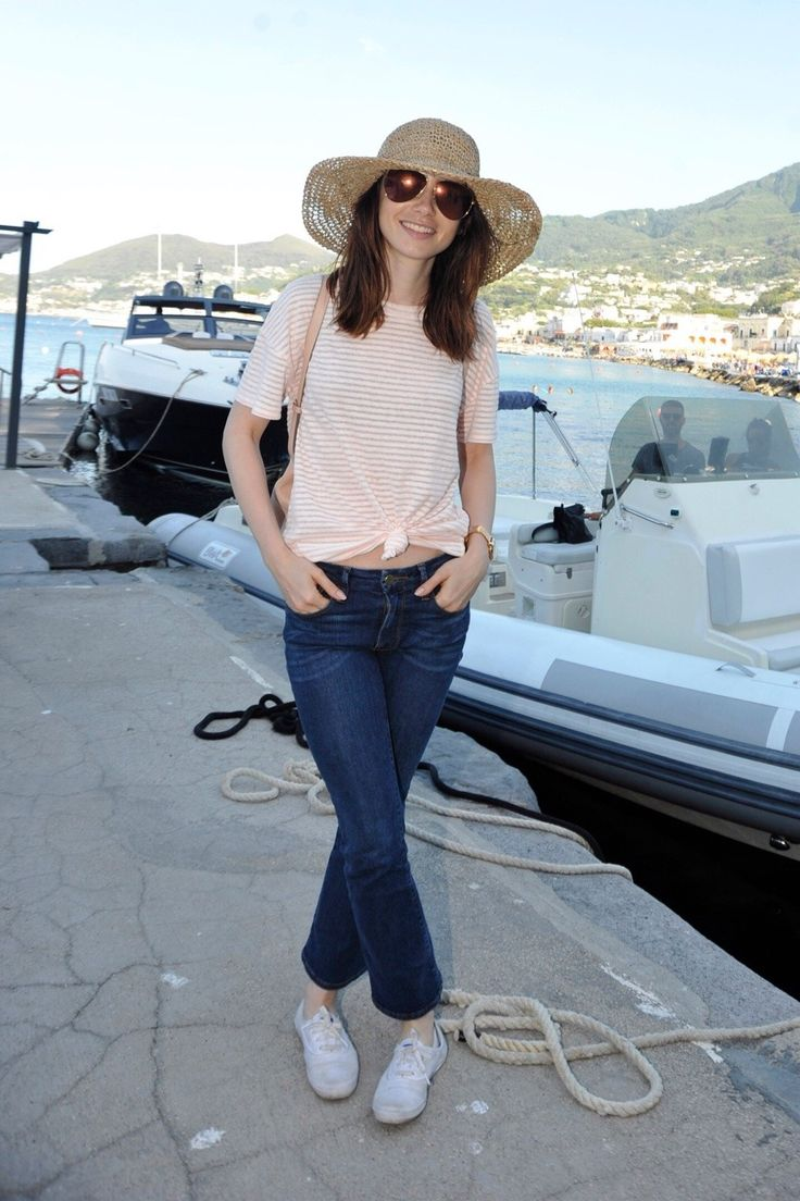07/14 | Lily Collins arriving on the Island of Ischia (Italia) for the «Ischia Global Fest» film festival.