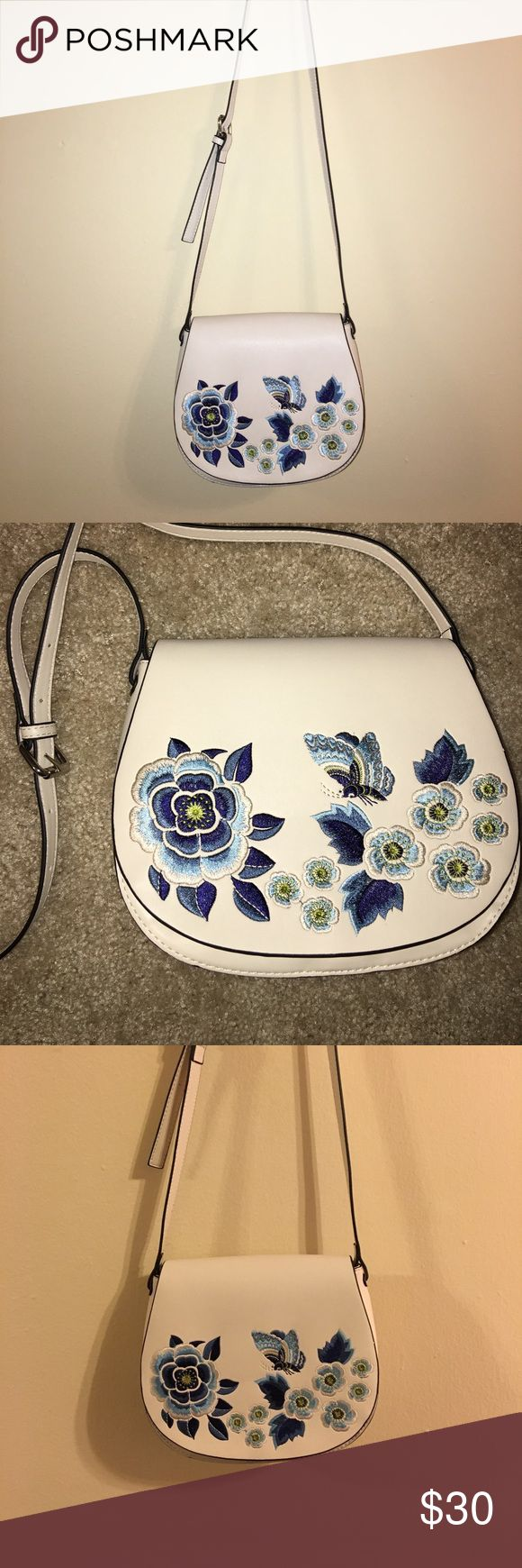 Summer time cross-body with blue detailing Such a cute purse with blue flower and bird detailing on the front. Medium sized about, not too large but fits a good amount inside. Adjustable strap and soft leather material. Perfect condition never used. French Connection Bags Crossbody Bags