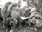Lieutenant R. A. Tilghman of 2nd Battalion, US 27th Marine Regiment held a briefing with his NCOs under fire, western Iwo Jima, at 1040 on 20 Feb 1945