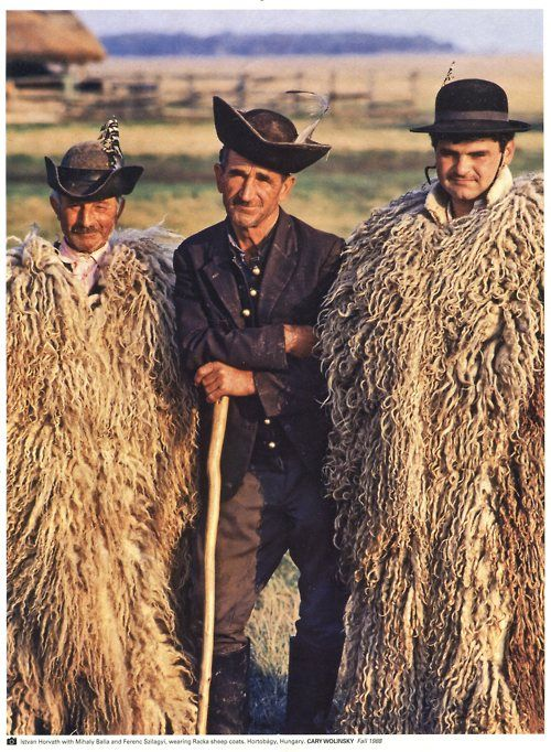 A picture taken of three men in Hungary in 1988.  Two of the men are wearing traditional Racka sheep coats.  Photo by Cary Wolinsky