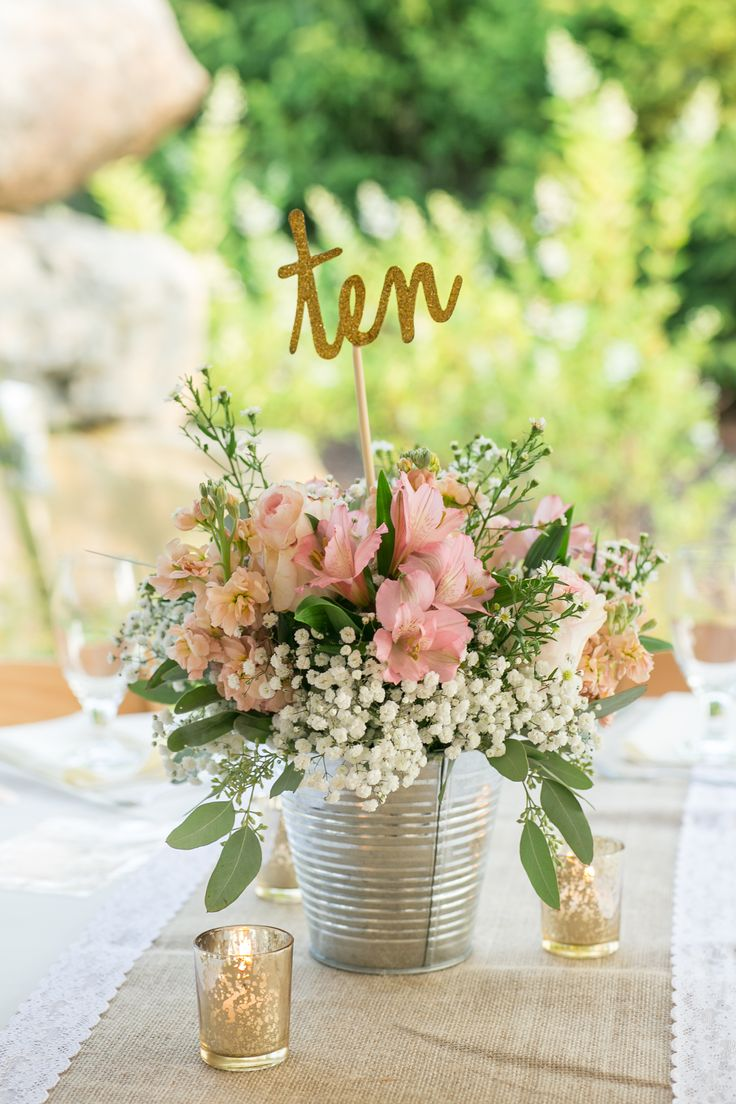 gold glitter wedding table numbers // blush wedding flowers // country wedding flowers // flowers in silver pail // galvanized pail wedding flowers // mercury glass votives // burlap and lace runner // country chic wedding