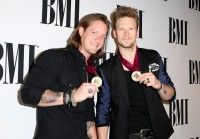 Musicians Tyler Hubbard (L) and Brian Kelley of Florida Georgia Line attend the 2014 BMI Pop Awards at the Beverly Wilshire Four Seasons Hotel on May 13, 2014 in Beverly Hills, California. (Photo by Chelsea Lauren/WireImage)