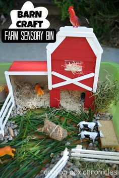Farm Small World Play + Barn Craft built from a cereal box, cardboard, and popsicle sticks by Crayon Box Chronicles