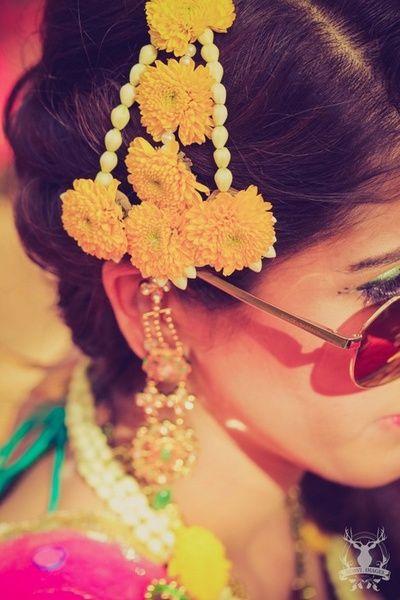 Floral jhoomer at the Mehendi | Find more wedding inspiration at www.wedmegood.com | #mehendi #indianwedding #floral