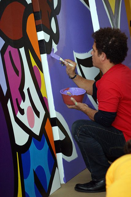 Romero Britto Born: October 6, 1963 Recife, Pernambuco, Brazil is a Neo-pop artist, painter, serigrapher, and sculptor. He combines elements of cubism, pop art and graffiti painting in his work, using vibrant colors and bold patterns.