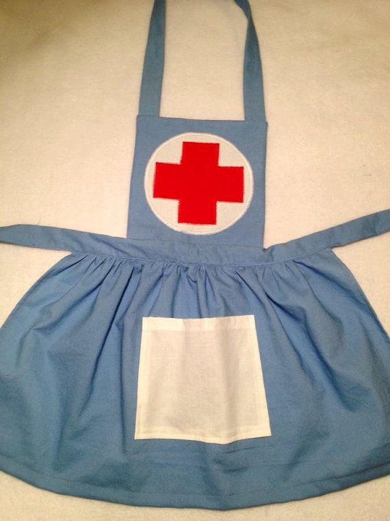 Dress up pretend nurse apron.  Perfect for pretend play.  Comes with felt bandaids for make believe wounded toys.