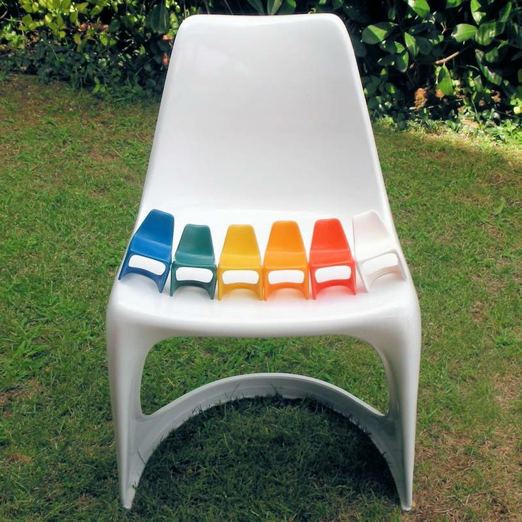 Miniature cantilever chairs on full scale 290 chair. Mini-maxi rainbow colors, Designed by Steen Ostergaard 1966, the miniature chairs are from early 70ies