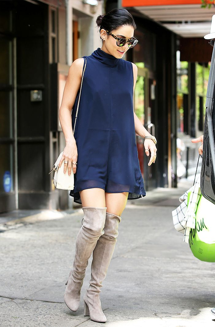 Vanessa Hudgens in a navy blue dress, taupe over-the-knee boots, white bag, and sunglasses