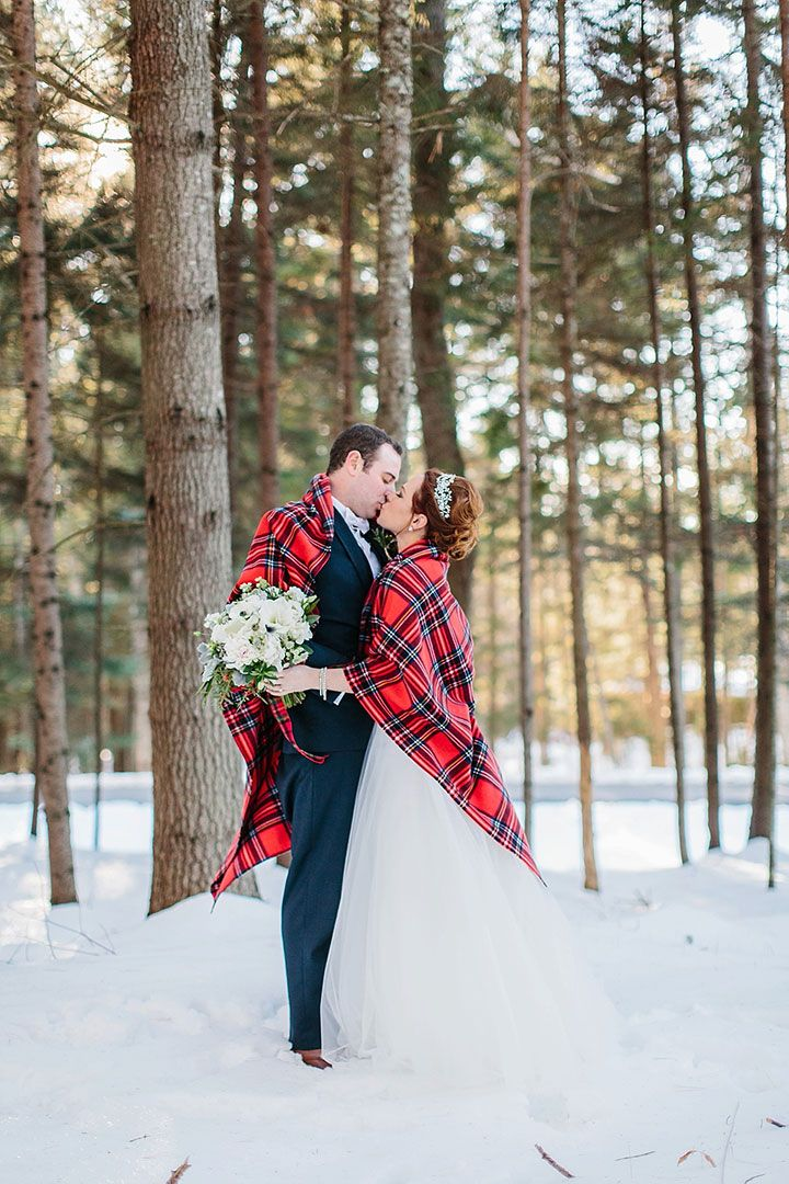 Love this red plaid blanket that added a festive look to this December wedding