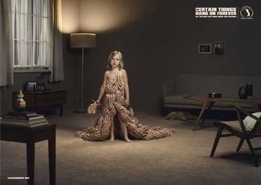 The image is an example of shock advertisement showing a young girl covered in hands. The young girl appears to be nude and is being touched meaning she is being sexually abused and the ad is saying that when this happens a person never forgets and suffers for the rest of his or her life.