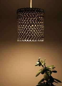Pendant Light made from Soda Can Tabs... And then hot glue the flat marble pebble things on top