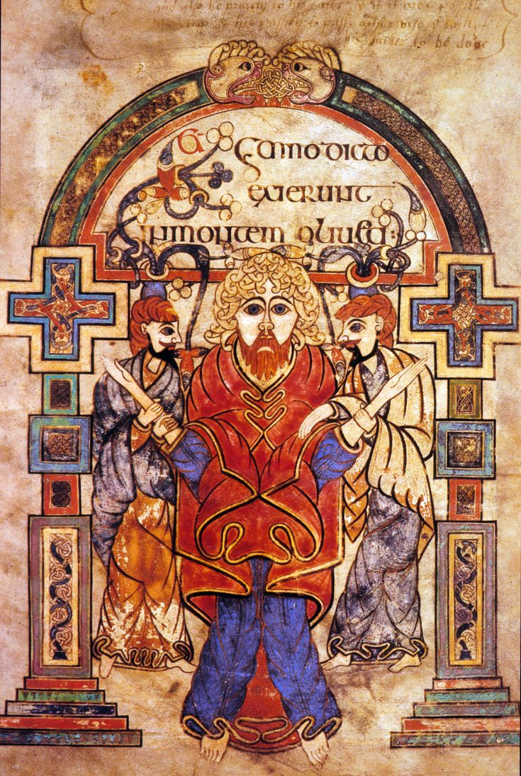 the book of kells - This seems to be the capture of Christ. Note the colours of his clothes. They contain red safron and blue which indicate the status of an Ard-File