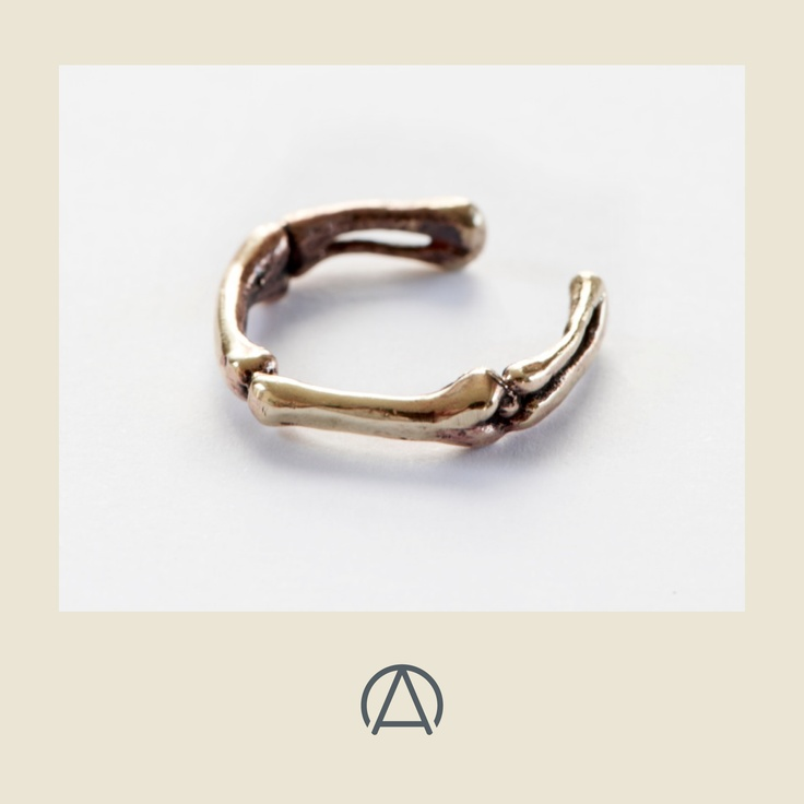 Brass femur ring by Famke Koene. Perfect for the natural specimens aesthetic that is so on-trend right now. FInd it on www.africandy.com very soon.