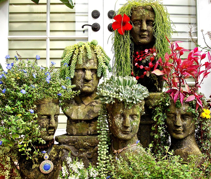 This is my Cranium family...a variety of head planters that live in my Garden