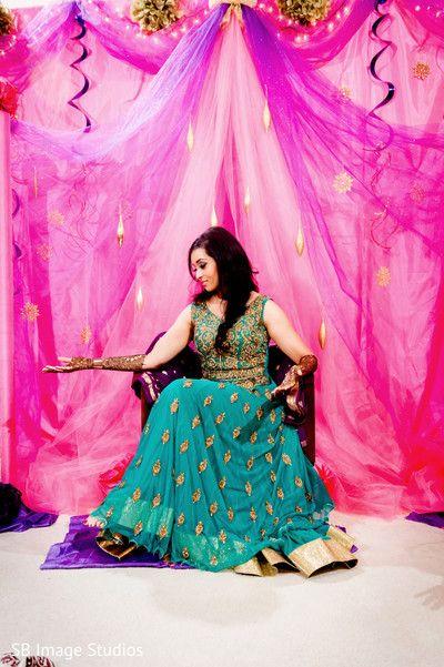 Indian bride posing with her lovely mehndi art. http://www.maharaniweddings.com/gallery/photo/96265