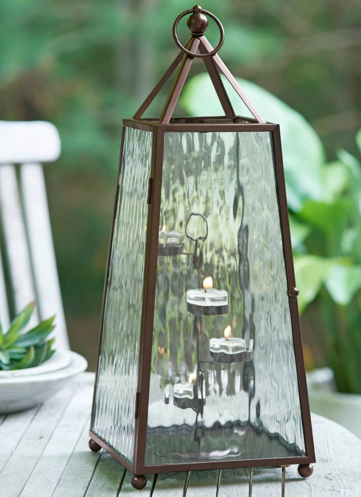 With its rich, aged bronze finish and textured glass panels, the Obelisk Lantern's tapered form pairs perfectly with PartyLite Tealights to light your way from Winter to Spring. This classic charmer is exclusively available to Party Hosts - contact your Consultant today. #PartyLitePreview #lantern #candlelight #PartyLitePreview