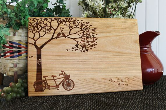 This personalized cutting board has the design of a tandem bike with love birds on one of the tree branches. The cutting board will make a