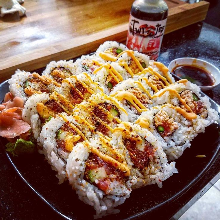 Crunchy Tuna Roll and A Cali Roll Rolled In Tempura Flakes. Topped with Spicy Mayo and The Twisted Chopstick All-in-One Sauce!