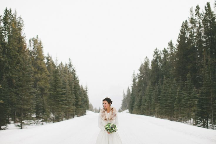 Our beautiful bride with her succulent bridal bouquet!  www.flowersbyjanie.com  Julia   Mike // Alberta Winter Destination Wedding Photographer | http://shariandmike.ca/blog/julia-mike-alberta-winter-destination-wedding-photographer/  #Rockymountainwedding #succulentbridalbouquet #Canmoreweddingflorist #Calgaryweddingflorist