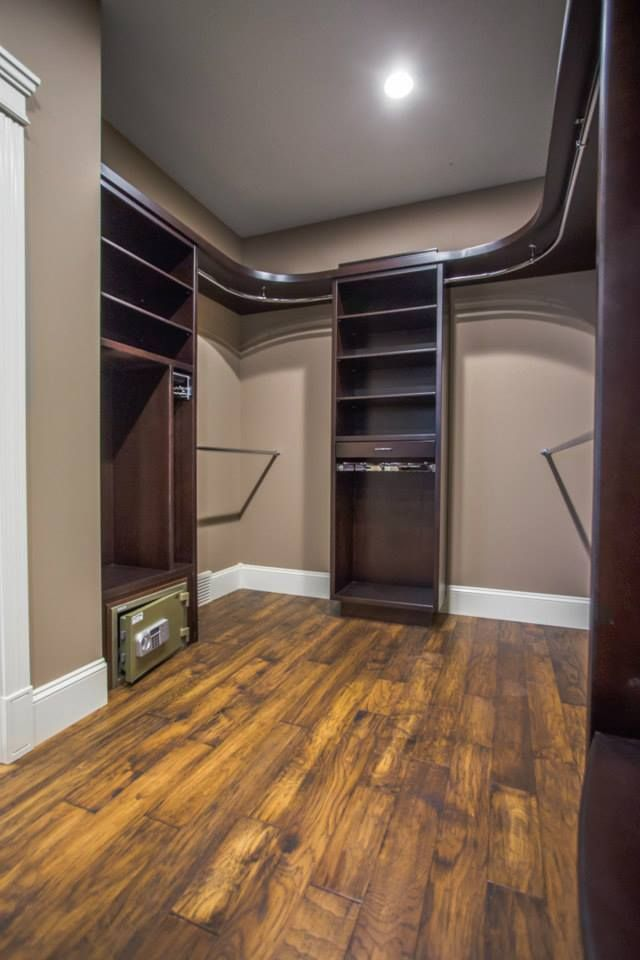 Custom Walk In Closet With Curved Shelves And Rods With