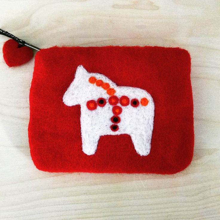 "Beautifully hand crafted Swedish Dala Horse felt make up bag from Klippan Yllefabrik in Skåne, Sweden. Measures 5 1/2"" by 4 1/4"". Lined. Beginning in the late 1700's , the men of Dalarna, a province i"