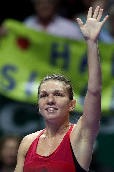 Simona Halep Photos - Simona Halep of Romania celebrates victory in her singles match against Caroline Garcia of France during day 2 of the BNP Paribas WTA Finals Singapore presented by SC Global at Singapore Sports Hub on October 23, 2017 in Singapore. - BNP Paribas WTA Finals Singapore Presented by SC Global - Day 2