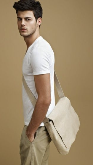 ...in neutral white shirt and beige pants, bag