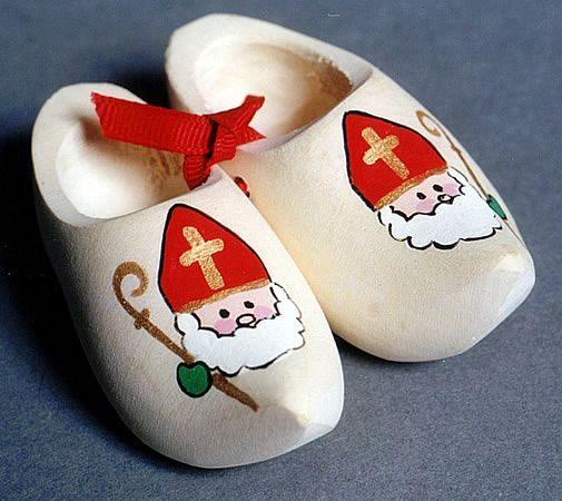 dutch sinterklaas...on the 5th of December we would put out Wooden shoes with a gift for Sinter Klaas and a carrot for his horse...Does anyone know if Zwarte Piet was left anything? I would leave it the night before ...