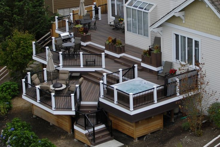 Multi-Tiered Decks | Here's an in incredible multi-tiered deck with white painted posts and ...