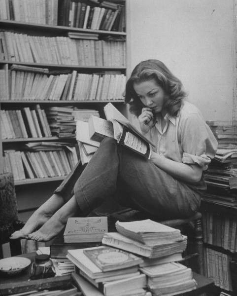 Love this photo of Sylvia Plath (Author of The Bell Jar) surrounded by books.