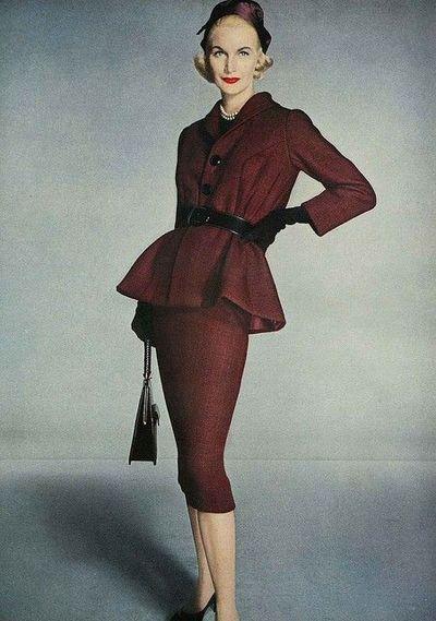 A piercingly sharp 1950s oxblood skirt suit.