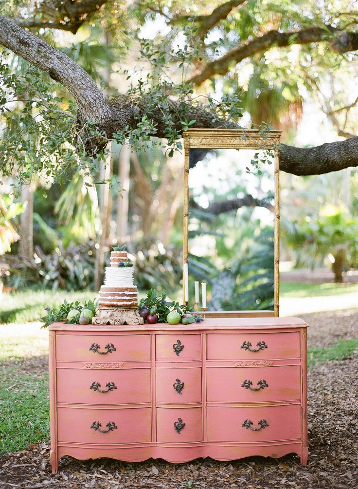 Vintage pink dresser with gold mirror used as  a wedding cake display. Cake by Cloud 9 Bakery, vintage rentals from The Salvage Snob and image by Gianny Campos Photography.