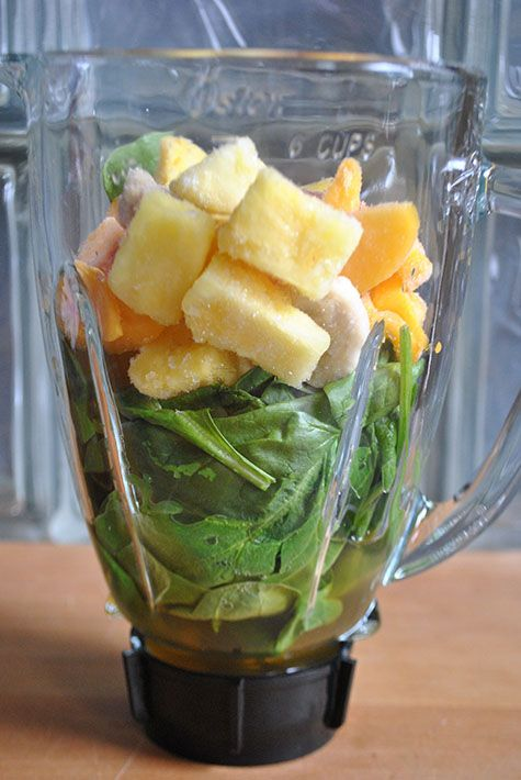 Green Spinach Smoothie Recipe - 2 cups of spinach, green tea, mango, pineapple, banana and honey.